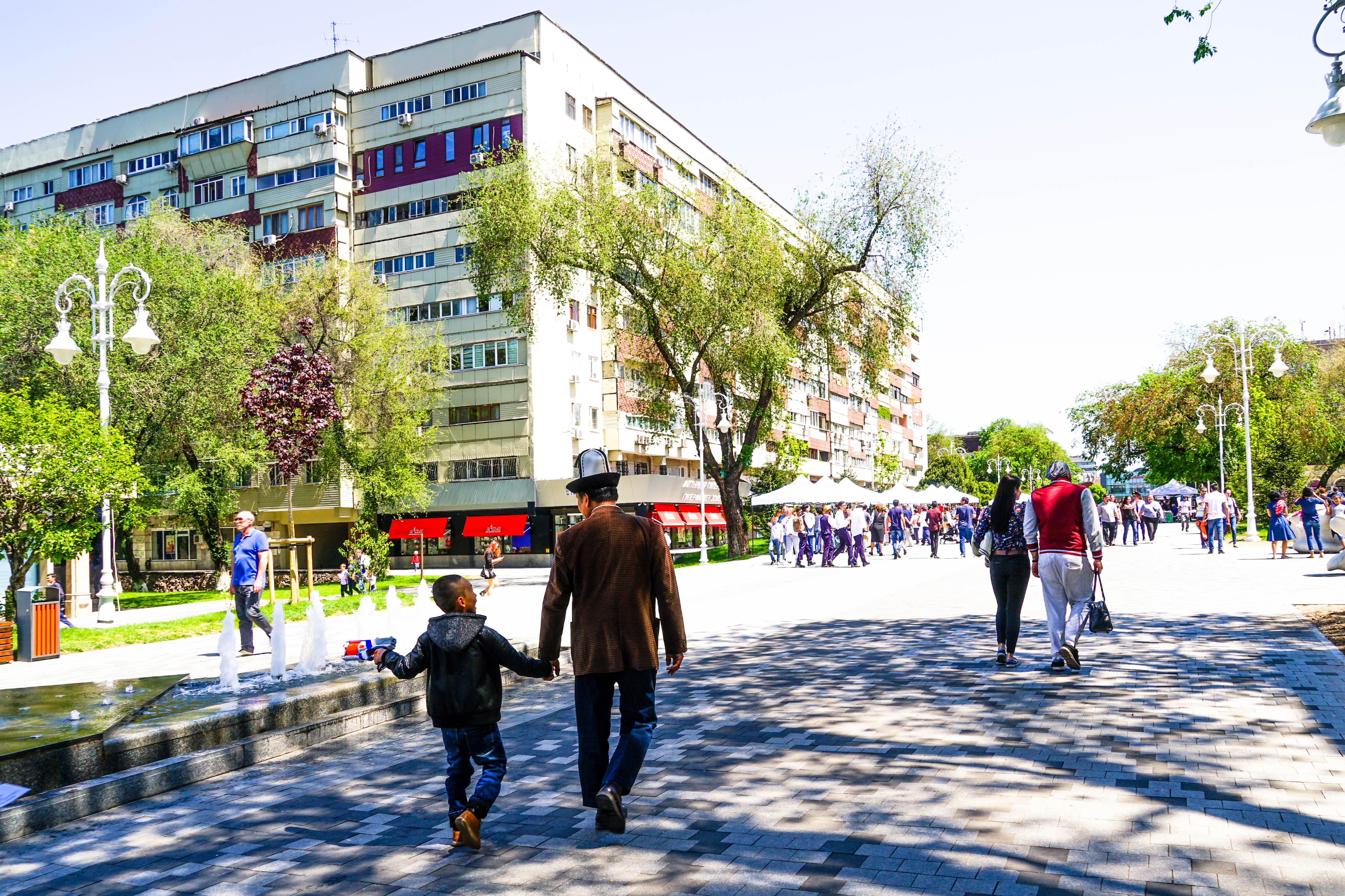 Man in Kalpak hat walking in Almaty Arbat