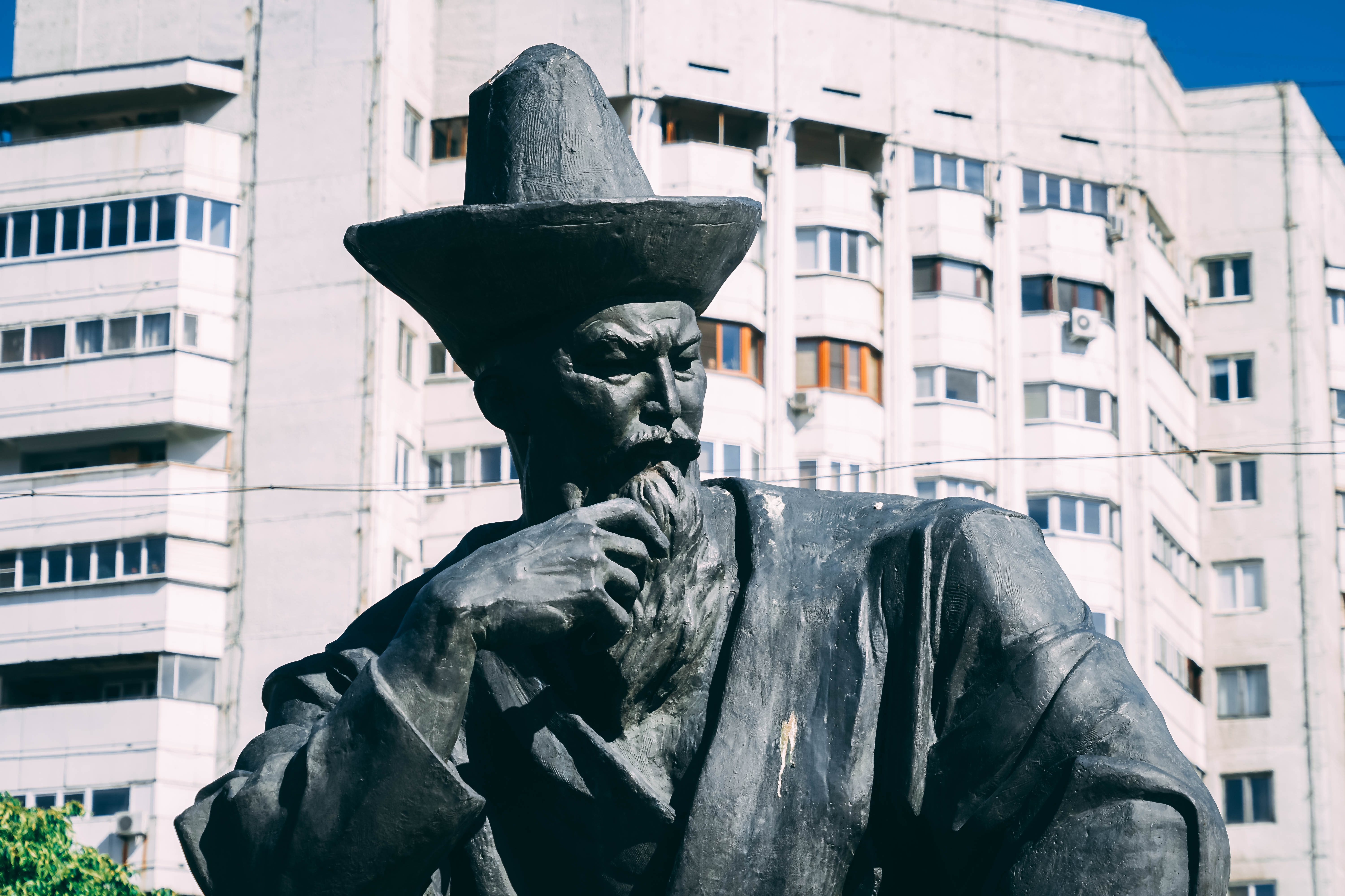 Almaty independence square wise man of heaven statue