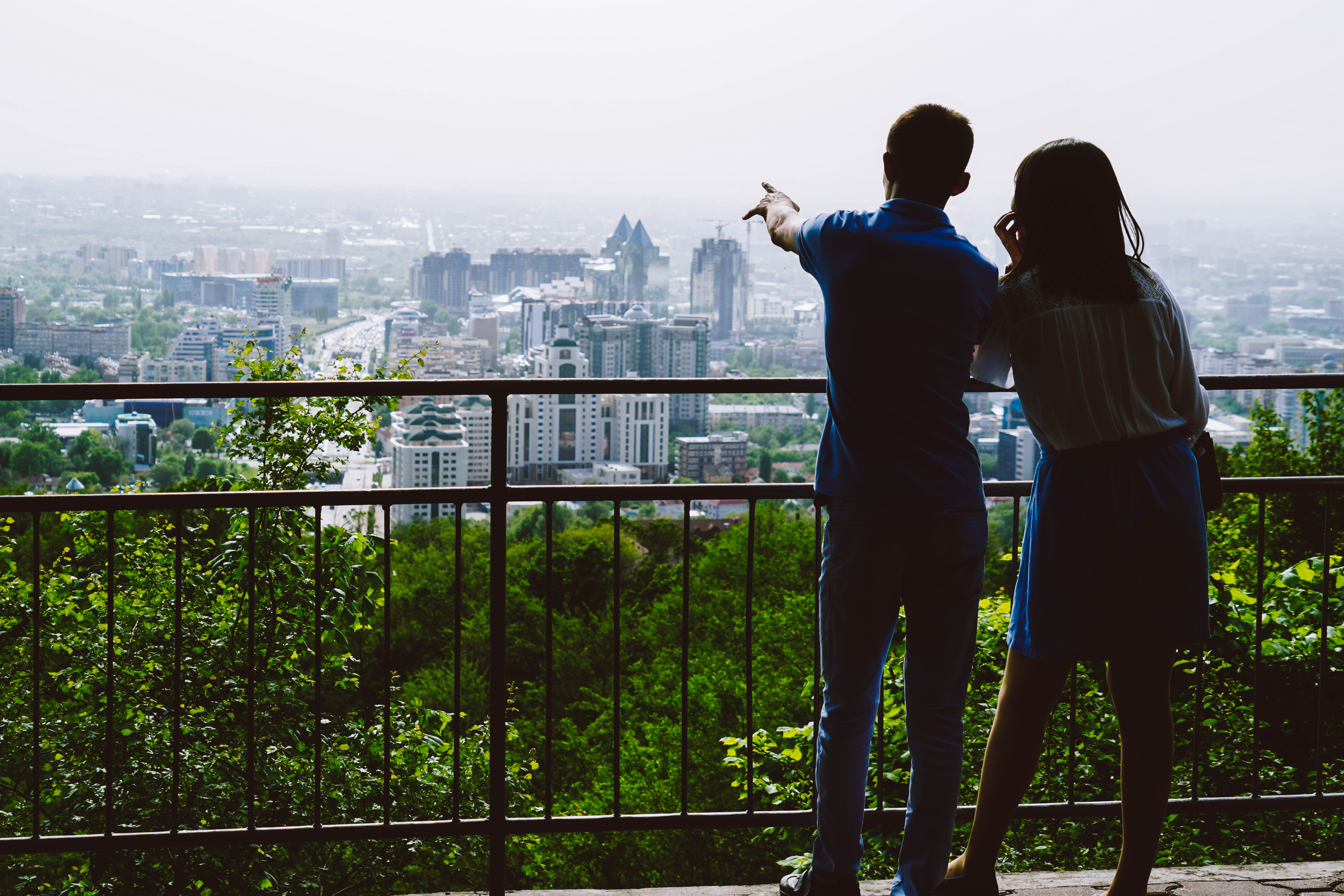 couple enjoying the view of Almaty from Kok Tobe Hill