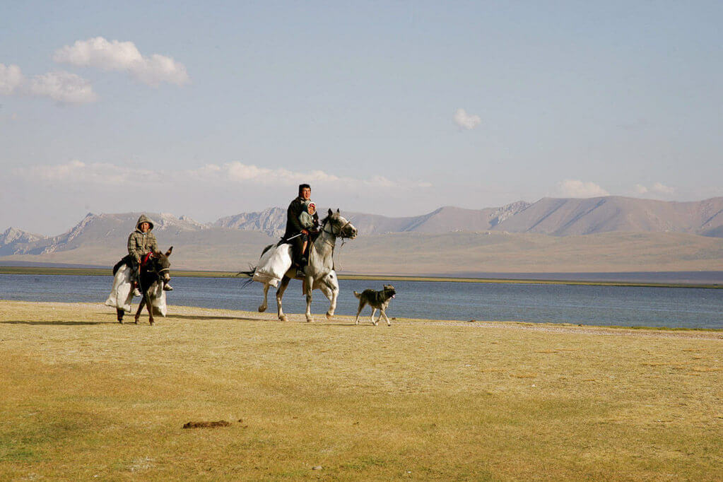 Central Asia tour locals riding at the lake